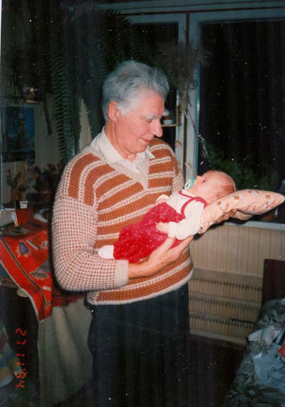 1995. Yuri Rogachev is 70; (with grandson)