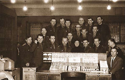 Computer STRELA; control panel. Major V.P. Isaev (the author) is the first on the right.